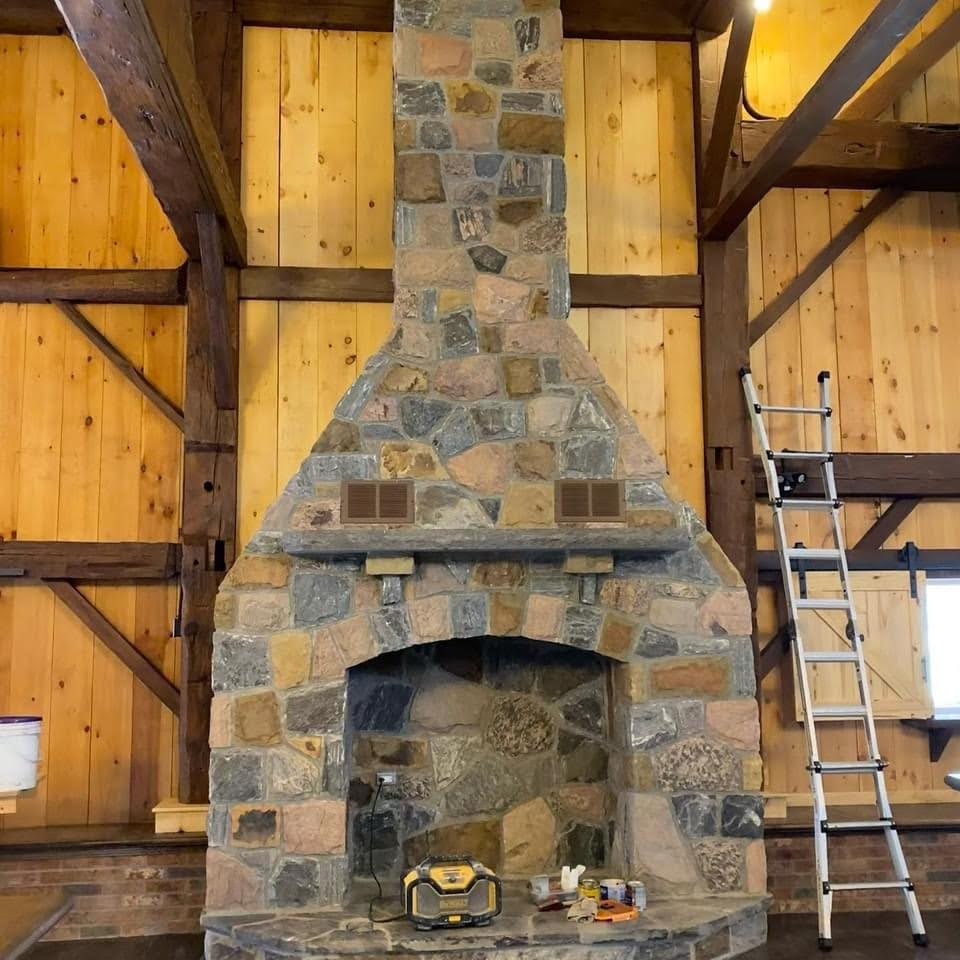 Stone fire place in a restored barn used as a wedding venue.