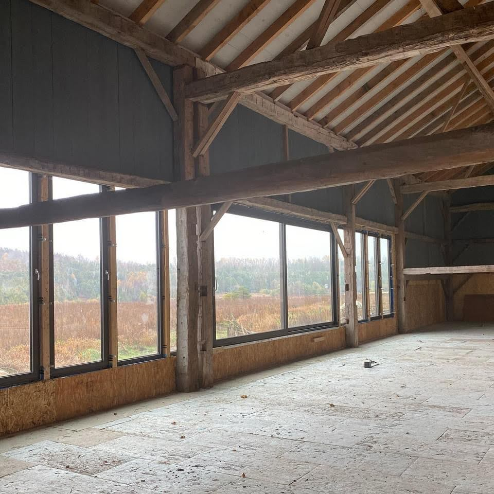 Large windows added to an existing timber barn.