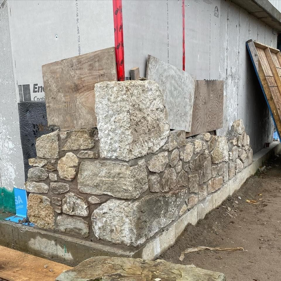 Masonry veneer being added to an existing timber barn.