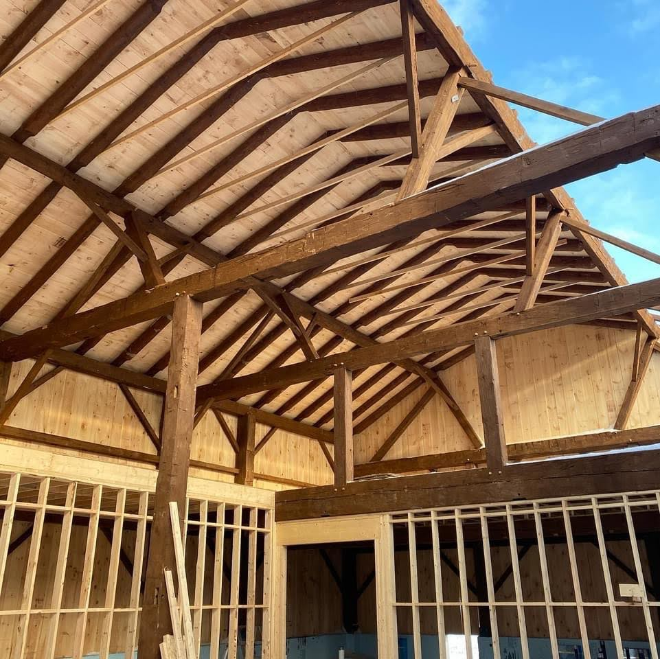 Interior view of timber frame roof.  Barn restoration project.  Timbers are reclaimed and cladding is new.