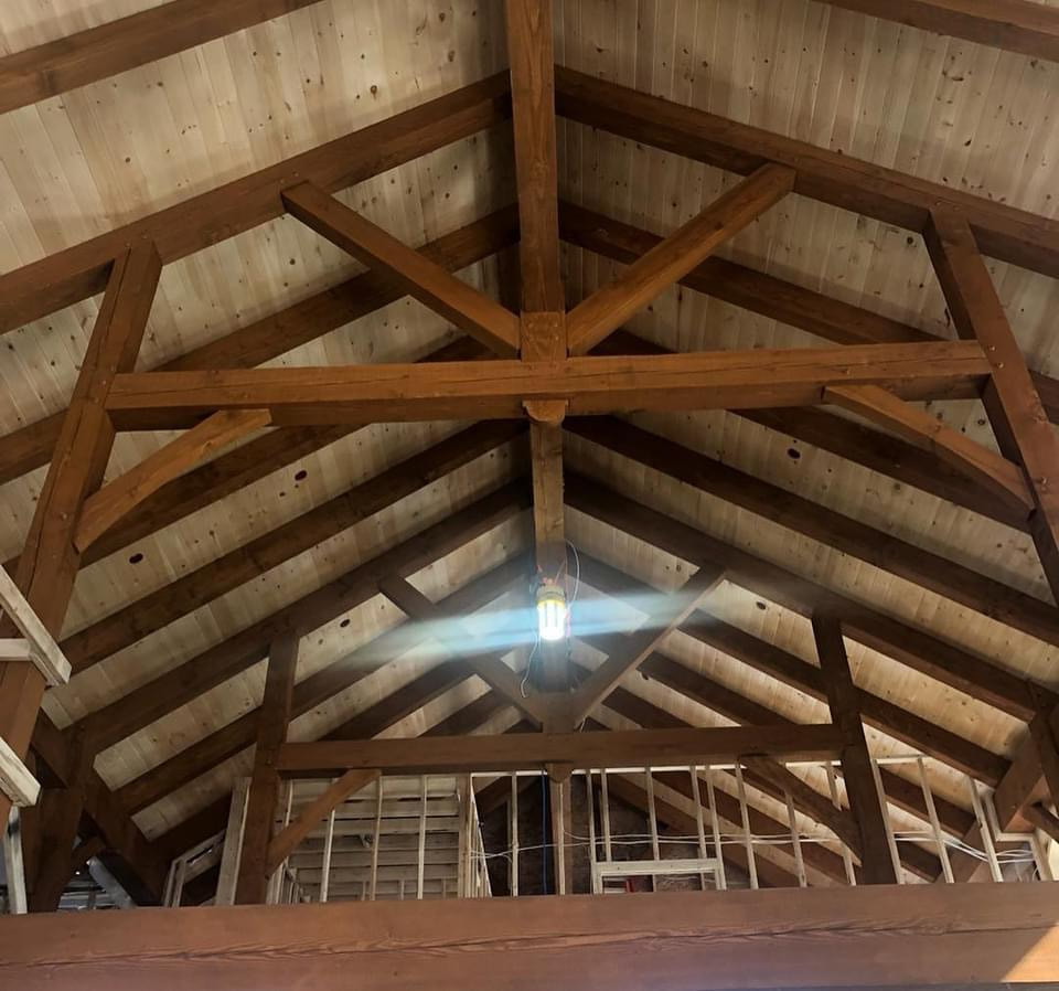 Timber framing in a houses great room.